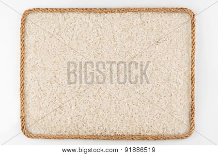 Frame Made Of Rope With Rice Grains  Lying On A White Background