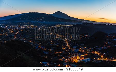Town With Illumination And Teide Volcano