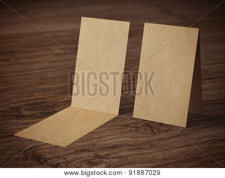 Two folded business cards