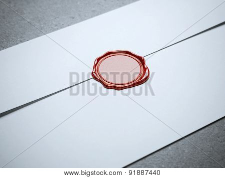 Red seal wax on white envelope