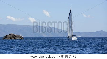 Sailboats participate in sailing regatta. Yachting. Luxury yachts.
