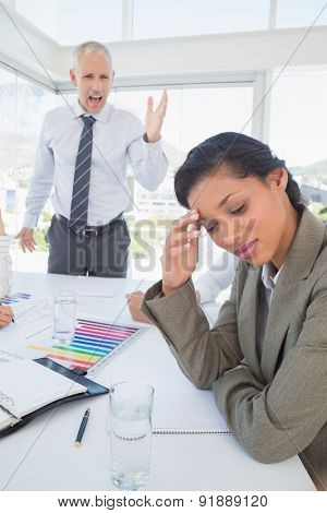 Businessman yelling at his colleague in the office