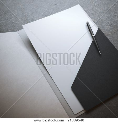 Black folder with pen