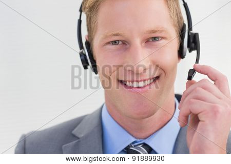 Handsome agent wearing headset in call center