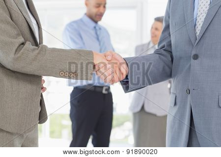 Businessmen shaking their hands in the office