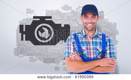 Happy repairman standing arms crossed on white background against grey vignette