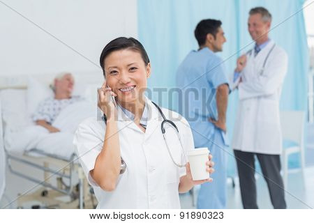 Doctor on phone at the hospital