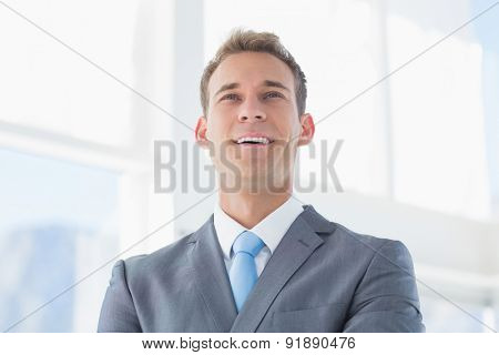 Smiling businessman looking away in the office