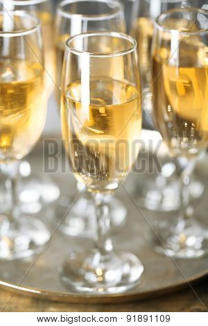 Glasses of champagne on bright background