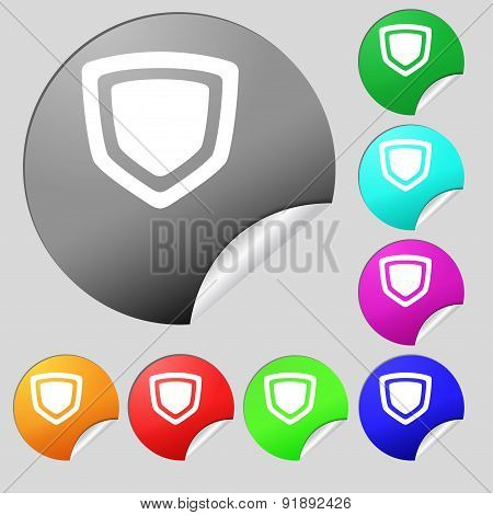 Shield Icon Sign. Set Of Eight Multi-colored Round Buttons, Stickers. Vector