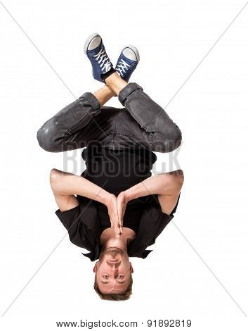 Young handsome fresh man breakdancing on white background