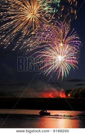 Fireworks Above Boat And River