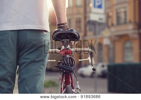 Closeup Of Stylish Biker With Vintage Race Bike