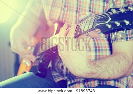 Guitarist on stage in the stagelight