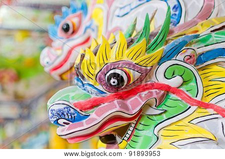 Festive colourful dragon stone head in buddha temple