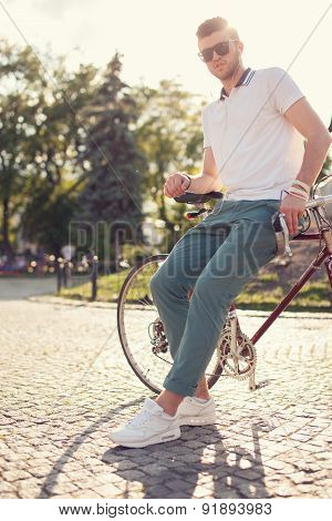 Stylish Guy Posing With Vintage Race Bike