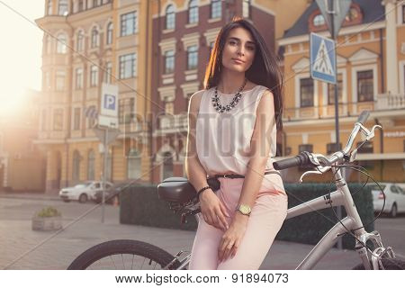 Young Beautiful Woman Posing With City Bike