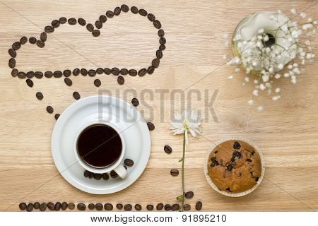 Top view coffee,muffins,flower and coffee beans