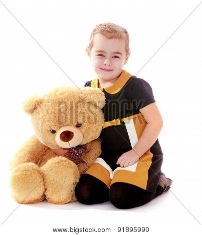 Beautiful elegant girl hugging Teddy bear