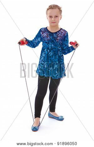 Little girl holding a skipping rope