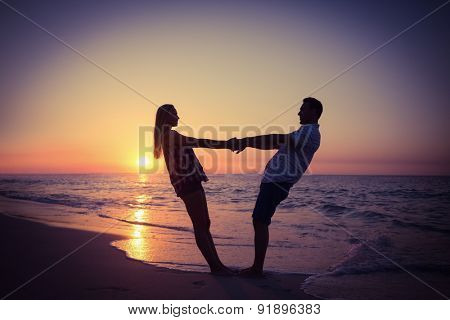 Romantic couple at sunset on the beach