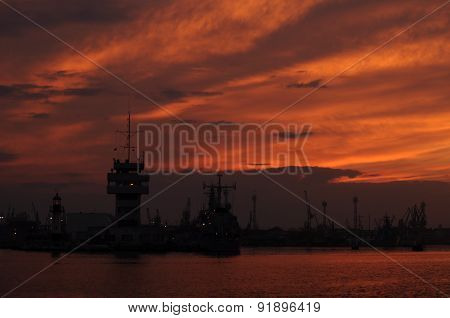 Sunset over an industry harbor with cranes in Bulgaria, Varna