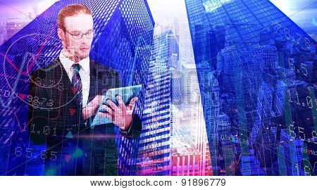 Unsmiling businessman using tablet pc against high angle view of city