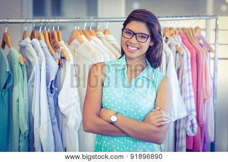 Happy shopper smiling at camera in boutique