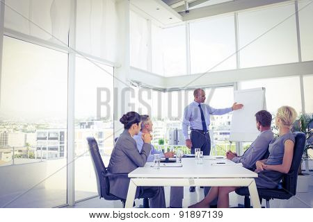 Businessman giving presentation to his colleagues in the office