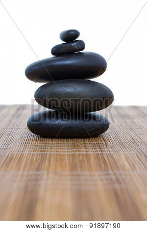 Tower of pebbles on white background