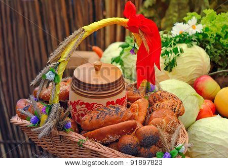 Basket Of Bread, Decorated With Ribbons, And Vegetables