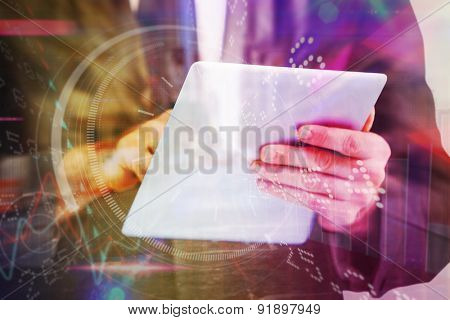 Businessman scrolling on his digital tablet against room with large window looking on city