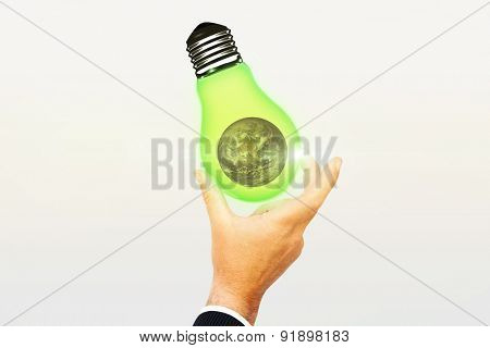 Businessman pointing with his finger against earth