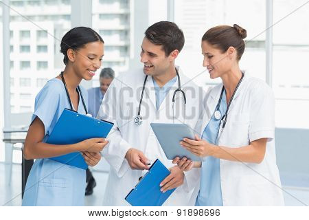 Portrait of doctors with arms crossed at medical office