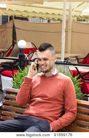 Businessman talking on the phone on the background of the city