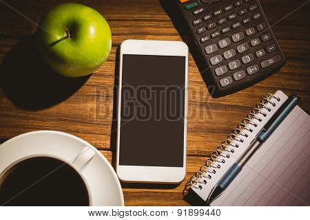 Overhead shot of smartphone on a students desk