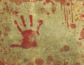 stock photo of gruesome  - Illustration of a background texture with bloody hand print and blood splattered and blood stained surface - JPG