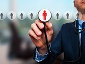 image of recruiting  - Businessman hand with stethoscope - JPG