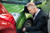 image of upset  - Upset Driver In Front Of Automobile Crash Car Collision - JPG