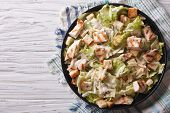 stock photo of caesar salad  - Caesar salad with chicken closeup on the plate - JPG
