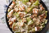 foto of caesar salad  - Caesar salad with chicken closeup on the table - JPG