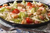 image of caesar salad  - Caesar salad with seafood and tomatoes close - JPG