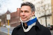 stock photo of cervix  - Man Suffering From Neck Ache Using Cervical Collar - JPG