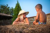 pic of hay bale  - Happy family on a hay bale - JPG