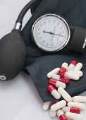 stock photo of sphygmomanometer  - Pills to control and sphygmomanometers to measure - JPG