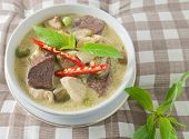 stock photo of curry chicken  - Thai Green Curry with Green Eggplant Chicken and Coconut Milk One of The Most Famous Curry Recipes in The World - JPG