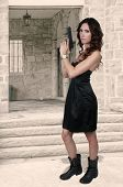 picture of handgun  - Beautiful young woman holding a loaded handgun - JPG