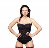 foto of corset  - Sexy woman posing in corset sensuality isolated on white - JPG