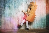stock photo of dragon  - Little dreamer boy playing with a cardboard dragon - JPG