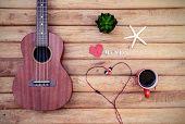 image of ukulele  - Cup of coffee with ukulele on old wooden background Vintage style - JPG